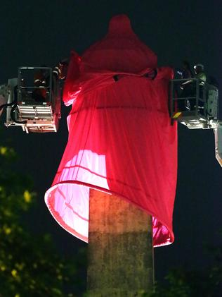 The condom was lowered onto the statue overnight.