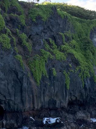 The vehicle driven by Alexandria Duval sits at the bottom of a cliff in Maui after falling at least 60 metres. Picture: AP