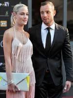 The Tragic Life of Reeva Steenkamp: South Africa's Olympic sprint star Oscar Pistorius and his model girlfriend Reeva Steenkamp. Pistorius has been charged with the Valentine's Day murder of Steenkamp, police confirmed on February 14, 2013 ahead of his expected court appearance. Photo: AFP/Lucky Nxumalo