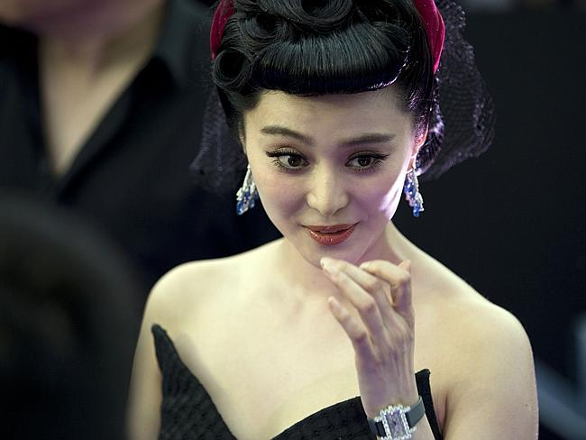 The Chinese star helps promote her  <i> X-Men</i> movie at the premiere in Beijing.