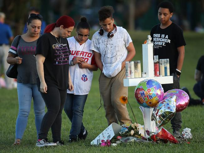People visit a memorial at Pine Trails Park for the students who were killed. Picture: Mark Wilson