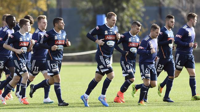 Besart Berisha, centre, says he is in it to win it at Melbourne Victory. Picture: Andy Brownbill