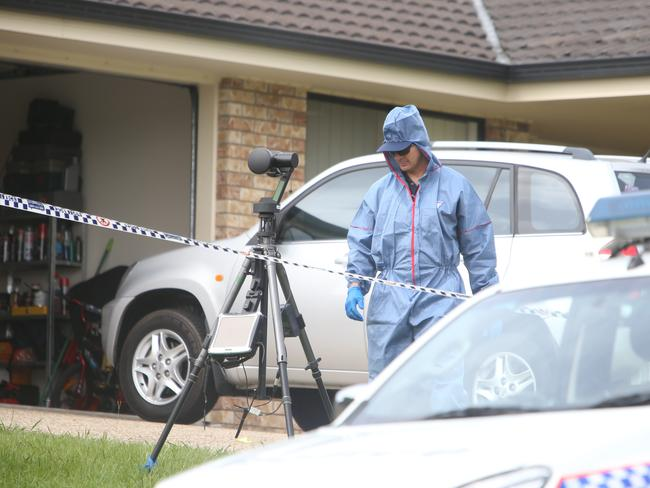 Police outside the couple's home. Picture: Annette Dew