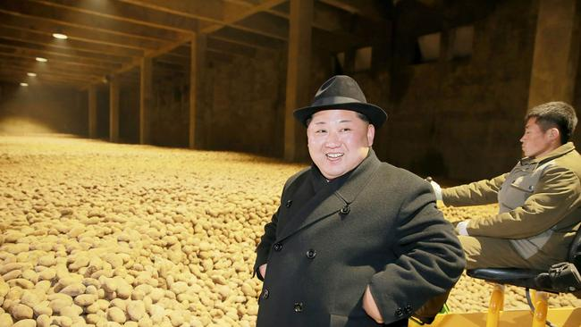 Mr Kim stands in front of potatoes at a potato flour factory inspection. Picture: KCNA via KNS/AFP