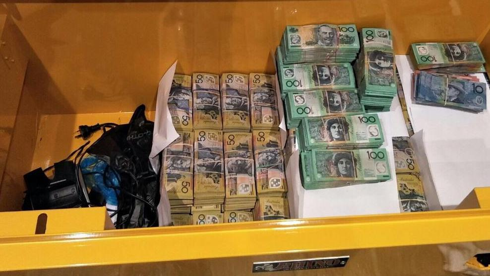 Detectives investigating money laundering have seized $3.6 million cash and a pistol with a silencer as part of Strike Force Millstream. Picture: NSW Police