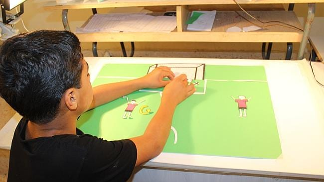 Yaarob, 13, films his football scene during an animation workshop run by Save the Children in Lebanon for Syrian refugees.