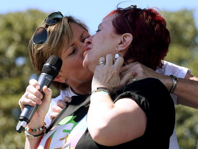 Tony Abbott's sister Christine Forster kisses her partner Virginia Edwards after the Yes announcement. Picture: Toby Zerna