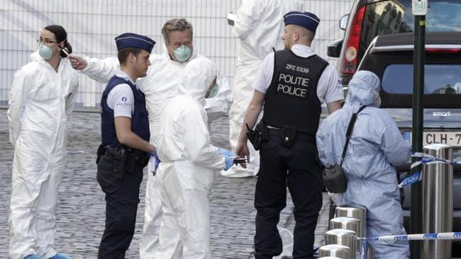 Searching for clues ... forensic experts examine the Jewish Museum of Belgium in Brussels where three people were shot dead. Picture: AP