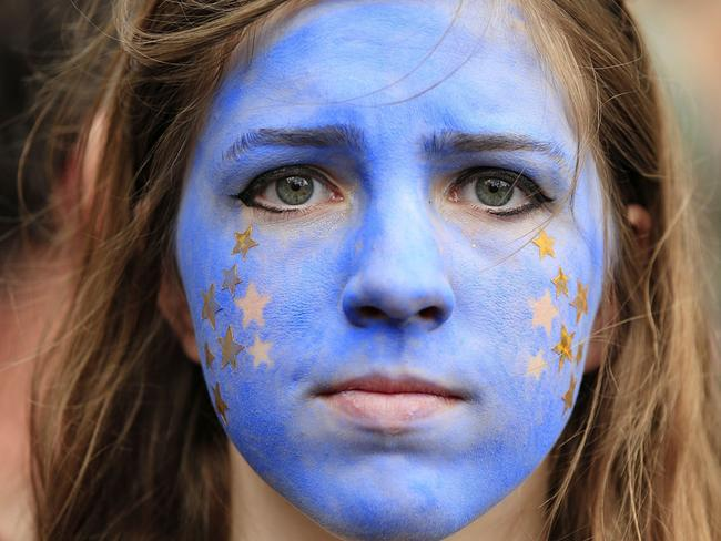 "A ""Remain"" supporter from 2016's Brexit referendum protests after the result. The campaign marked bitter division lines in UK politics and continues to dominate the political spectrum, 15 months on. Picture: Jonathan Brady/PA via AP"