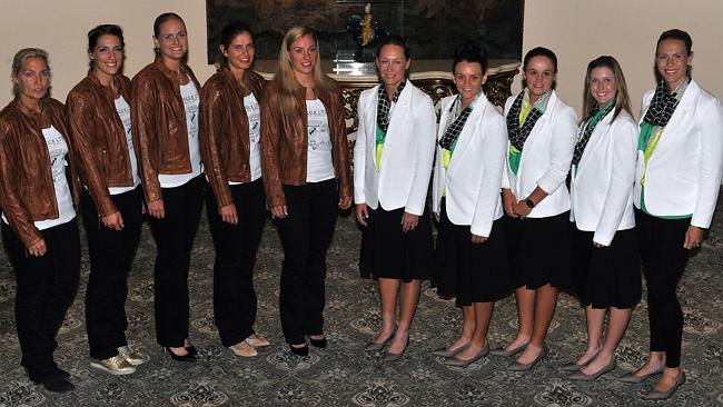 The German Fed Cup team (L-R) Coach Barbara Rittner, Anna Petkovic, Anna-Lena Groenefeld, Julia Goerges and Angelique Kerber and the Australian Federation Cup Team (L-R) Samantha Stosur, Casey Dellacqua, Ashleigh Barty and Storm Sanders pose for a photo during the Fed Cup official dinner.