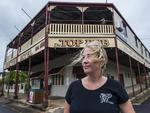 She only bought this historic Cooktown pub a week ago and now Michelle Thompson is preparing for Cyclone Ita. Picture: Brian Cassey