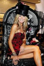 <p>Supermodel Heidi Klum poses after cutting the ribbon at the new Victoria's Secret flagship store on Lexington Avenue in New York City, Dec. 2, 2008. AP Photo</p>