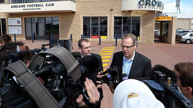 Adelaide Crows CEO Steven Trigg arrives at West Lakes as investigators - who are already in the building - seize bank and computer records. Picture: Sarah Reed