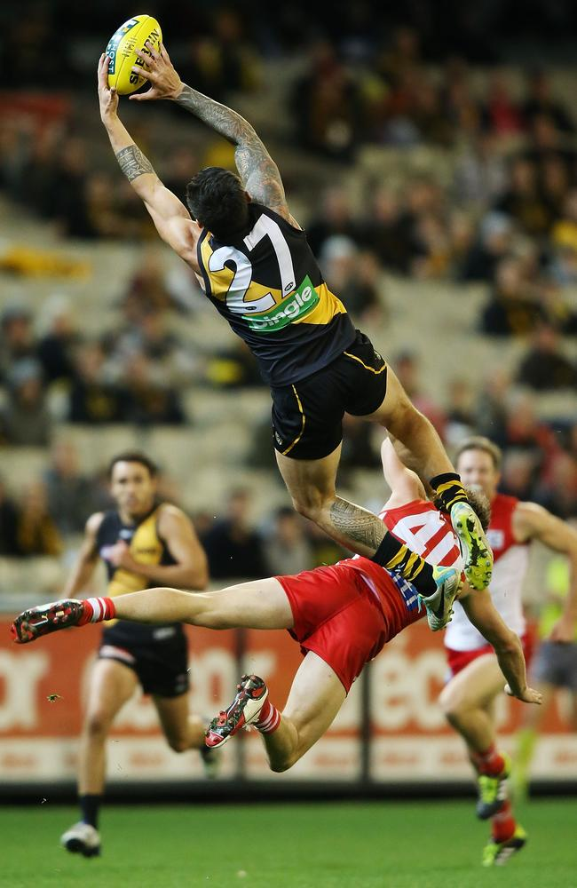 Aaron Edwards flies high over Nick Smith.