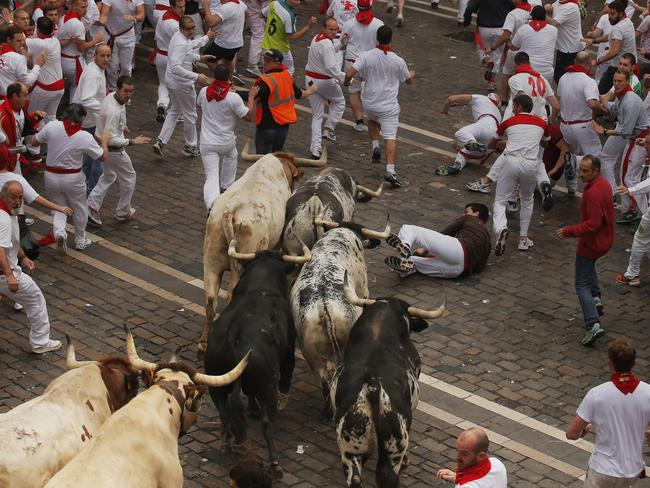 Better be quick ... the running of the bulls in Pamplona lures hundreds of foreigners every year.