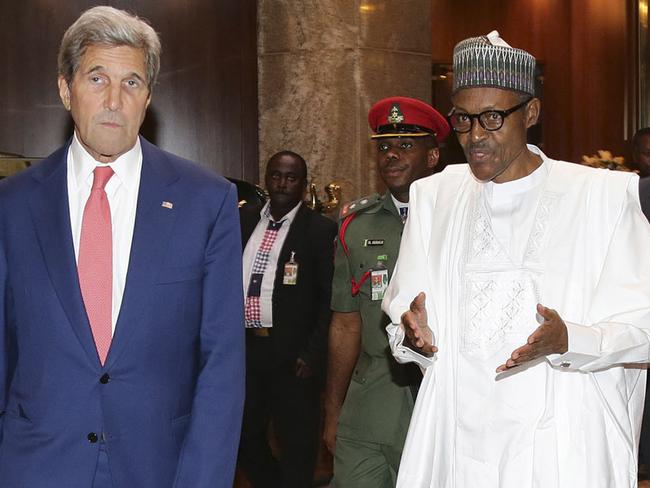President Muhammadu Buhari (R) with former US Secretary of State John Kerry. The US offered $7 million reward for the arrest of the Boko Haram leader. Picture: AFP