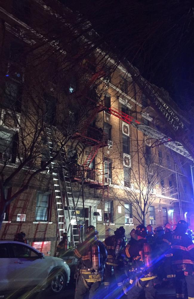 Ladders reach to the upper floors of a burning apartment block in the Bronx. Picture: New York Fire Department.