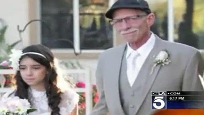 Bittersweet ... terminally ill Jim Zets walks his daughter down the aisle in a mock wedding ceremony.