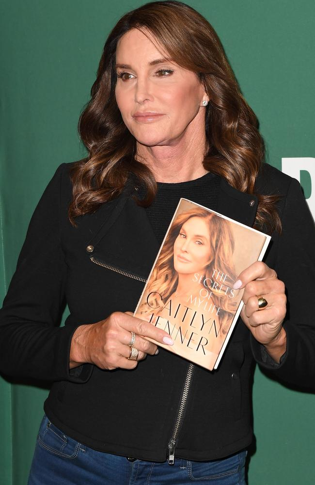 Caitlyn Jenner holds a copy of her book, The Secrets of My Life. Picture: AFP/Angela Weiss