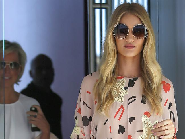 Rosie Huntington-Whiteley leaves Bondi Icebergs after having lunch with ModelCo boss Shelley Barrett. Picture: Bradley Hunter