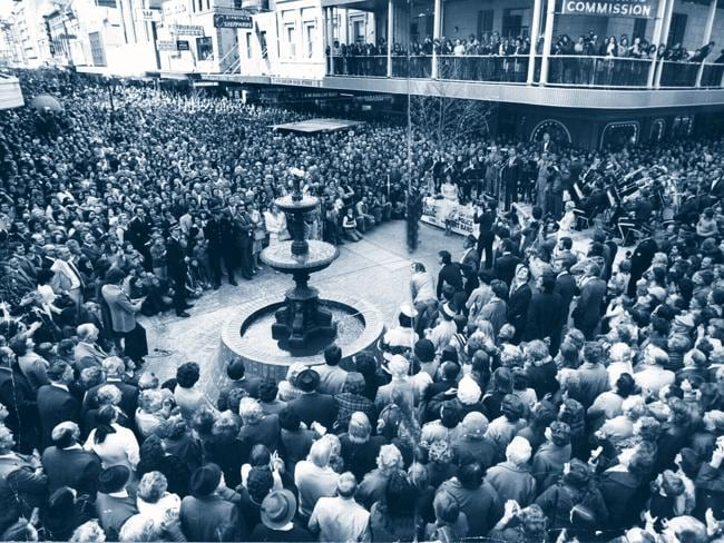 Champagne bubbles from the Rundle Mall fountain as massive crowd watches former premier Don Dunstan open the Mall in 1976.