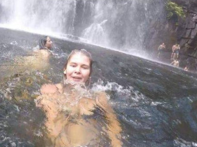 nneka Bading was swimming at a Victoria waterfall on Saturday when a man who was part of the group pictured behind her fell into the water and drowned. Picture: Anneke Bading/Facebook.