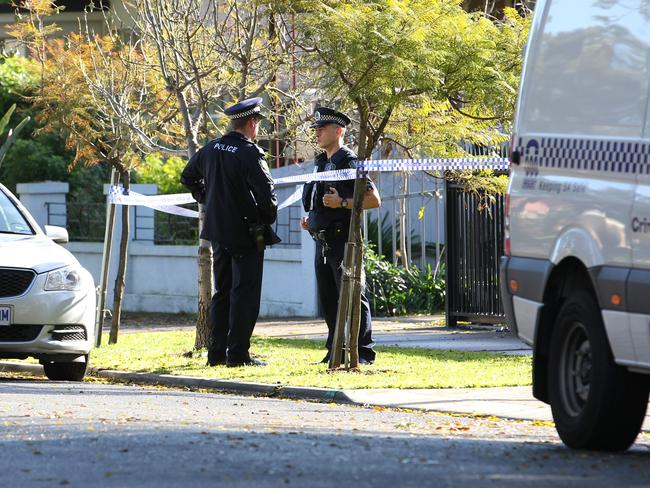 Police at the scene of a murder in Adelaide yesterday. Picture Stephen Laffer