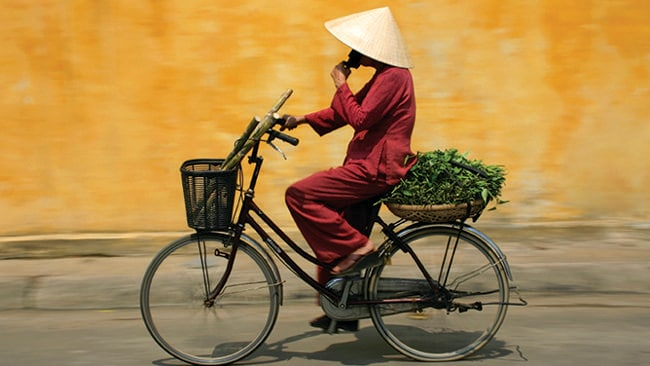 Join the locals or cycle on your own. Whatever you do, you'll love cycling through Vietnam. Picture: Supplied