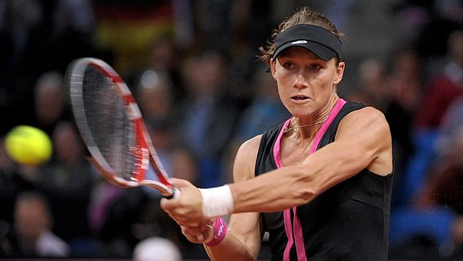 Stosur playing against Andrea Petkovic in a Fed Cup tie between Germany and Australia in 2012.
