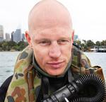 <p>Able Seaman Paul Degelder lost a hand during the terrifying shark attack.</p>