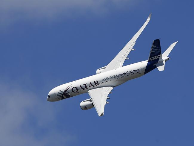 An Airbus A350 XWB flies on display during Farnborough International Air Show.
