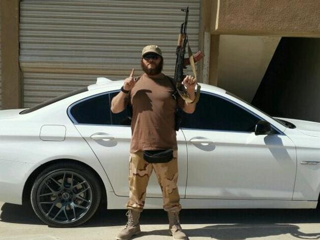 Australian terrorist Khaled Sharrouf posing with an AK-47 in front of a sports car from an undisclosed location within Iraq. Photo: Twitter
