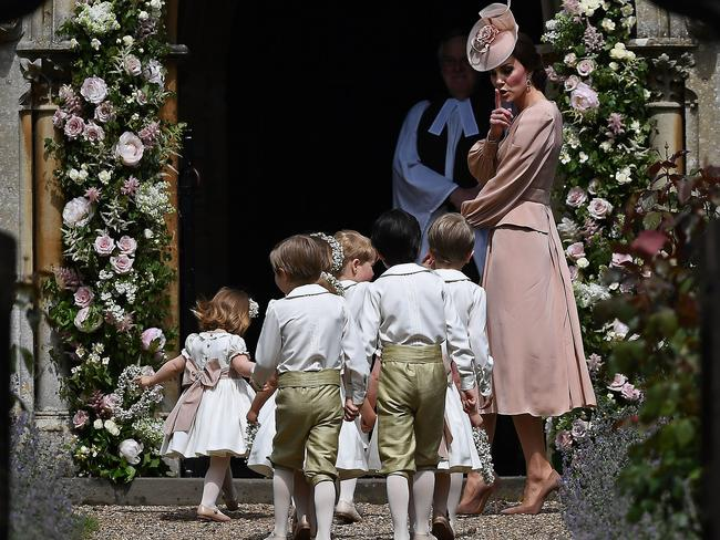 Keeping everyone in line. The Duchess of Cambridge leads the bridesmaids and pageboys into the church ahead of her sister Pippa Middleton's wedding. Picture: AFP PHOTO / POOL AND AFP PHOTO / Justin TALLIS