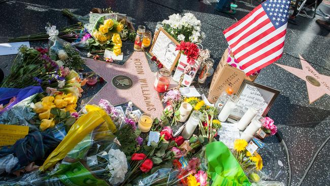 Outpouring of grief ... a shrine to Robin Williams at his star on the Hollywood Walk of Fame. Picture: Getty Images