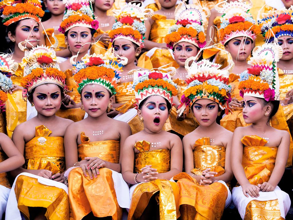 """This image was taken in Bali during Melasti Festival. These young girls were waiting for their turn to perform."" Picture: Khairel Anuar Che Ani, Malaysia, Shortlisted, Open Competition, Split Second, 2016 Sony World Photography Awards"