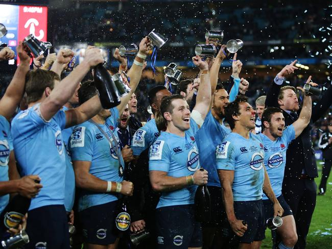 The NSW Waratahs celebrate their victory in the Super Rugby final.