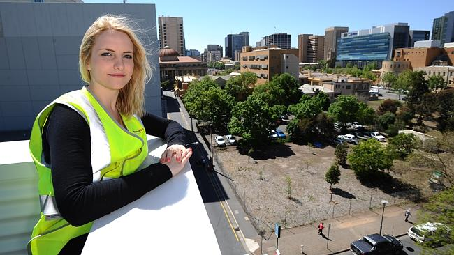 Stage one of the Ergo Apartments (City Council and Hindmarsh Development project) has sold out. New Home buyer Shannon McLay, on top of the building taking in city views.