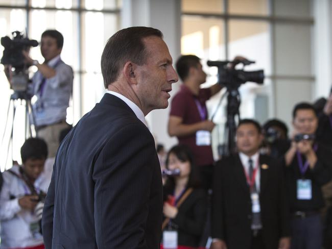 Ahead of G20 ... Prime Minister Tony Abbott arrives on the second day of the ASEAN summit on November 13 in Naypyidaw, Myanmar. Picture: Getty