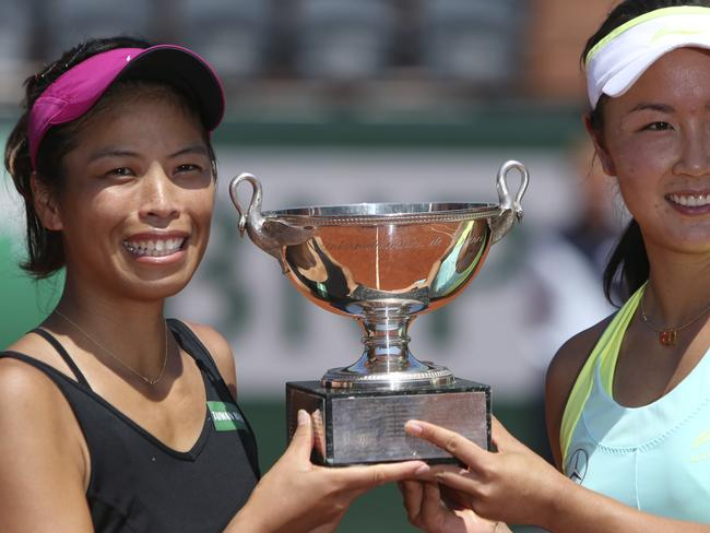 The winning partnership show off their women's doubles trophy. Picture: Thibault Camus