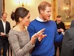 Prince Harry and Meghan Markle chat with people inside the Drawing Room during a visit to Cardiff Castle on January 18, 2018 in Cardiff, Wales. Picture: Getty