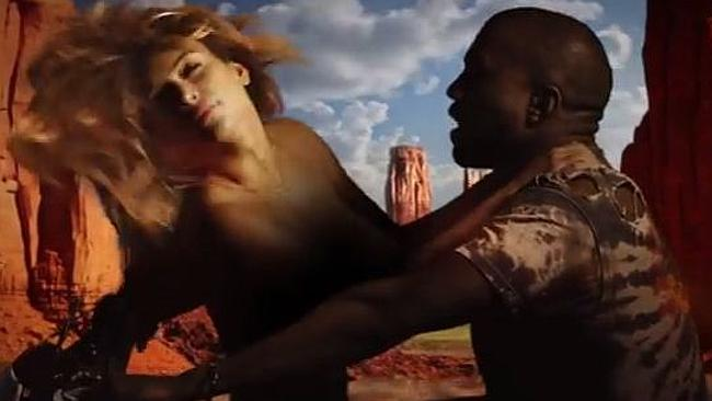 The video for Kanye West's Bound features his fiancée Kim Kardashian, topless, riding on a motorbike with West through Monument Valley and other landscapes. Source: YouTube
