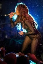 <p>Jennifer Lopez performs as a light rain fell on the Nivea Countdown Stage on Times Square in New York Thursday, Dec. 31, 2009.</p>