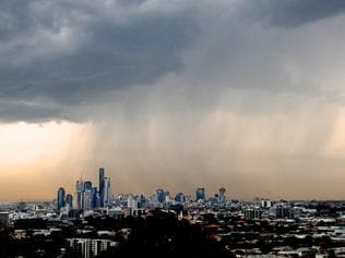BCM NEWS 21/9/2012. Rain clouds over Brisbane City. Photographer: Liam Kidston.