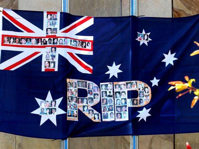 An Australian flag with picture's of Bali bomb victim's erected at the memorial in Kuta for the 15th anniversary of the Bali bombings last month. Picture: Lukman S. Bintoro