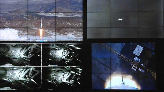 Various images shown on screens at the General Satellite Control and Command Center show the launch of North Korea's Unha-3 rocket on Wednesday, Dec. 12, 2012, in Pyongyang, North Korea. (AP Photo)