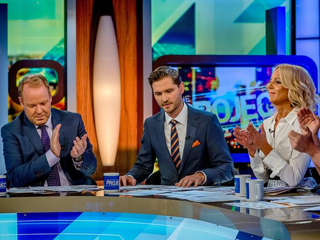 Announcing his resignation ... Charlie Pickering gets a round of applause from his co-hosts on The Project Peter Helliar (left) and Carrie Bickmore. Picture: Hamish Blair
