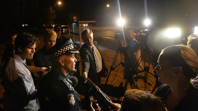 Commander Doug Fryer talks to the media at the scene last night. Picture: Jay Town