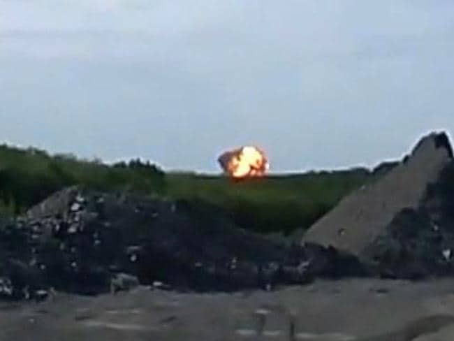 In this image taken from amateur video, a fireball is seen shortly after the Malaysia Airlines passenger plane was shot down as it flew over Ukraine. Picture: AP