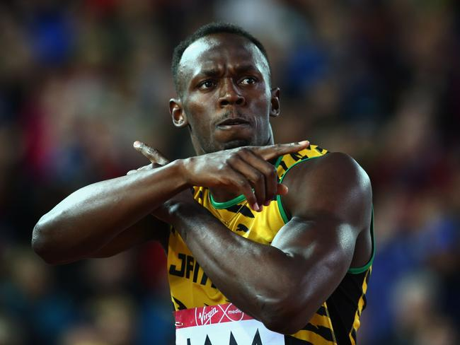 Usain Bolt of Jamaica celebrates winning gold in the men's 4x100m relay at the Commonwealth Games.