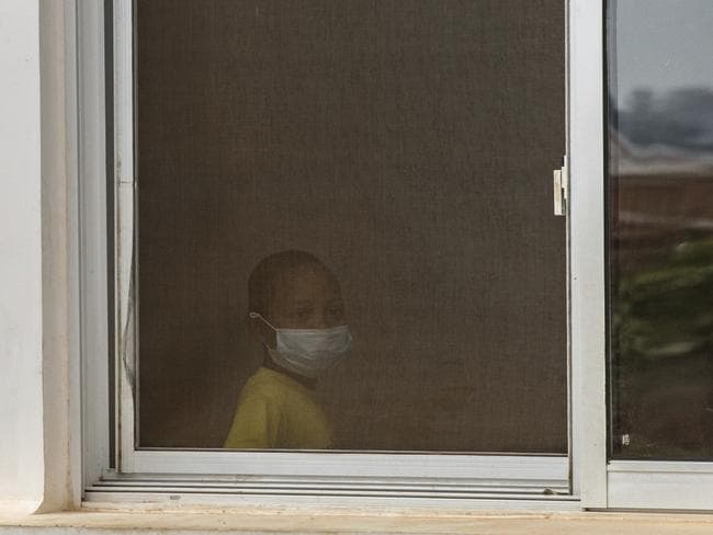 A child wears a face mask inside a hospital in the Madagascar capital of Antananarivo. Picture: AP/Alexander Joe